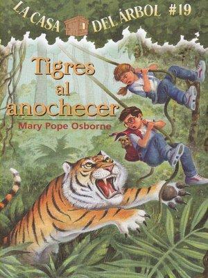 cover image of Tigres al anochecer